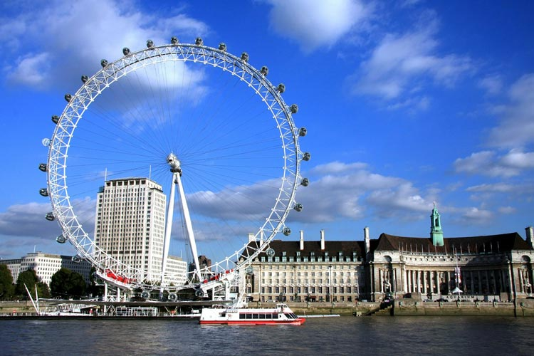 The London Eye sits along the South Bank of the River Thames for views of the entire city.