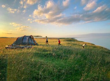 A family camping on the coast