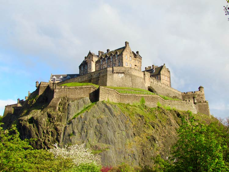 Edinburgh Castle on Castle Rock towering over Edinburgh, Scotland.