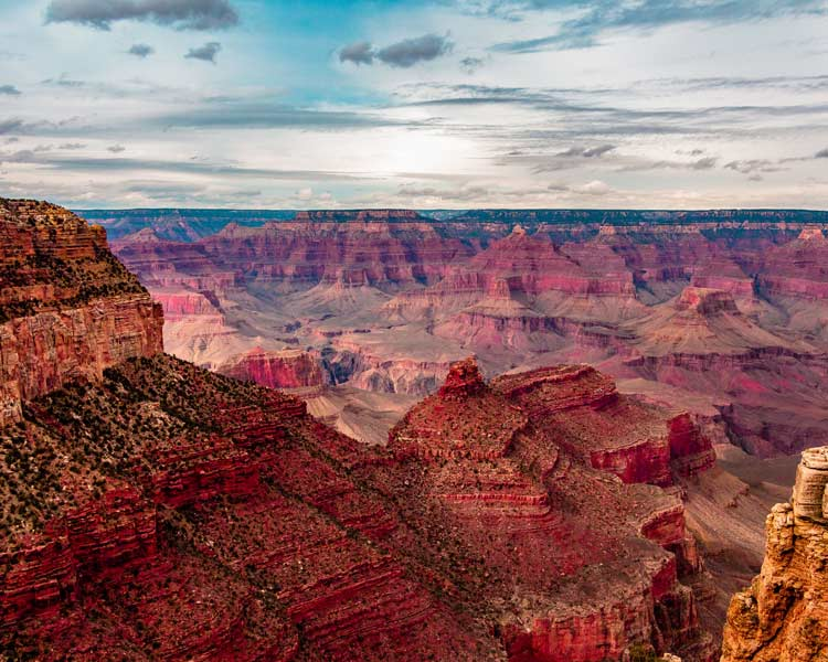 Overlooking the vibrant red Grand Canyon in Arizona.