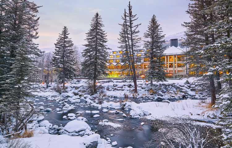 View of Grand Hyatt Hotel from the snowy Gore Creek.