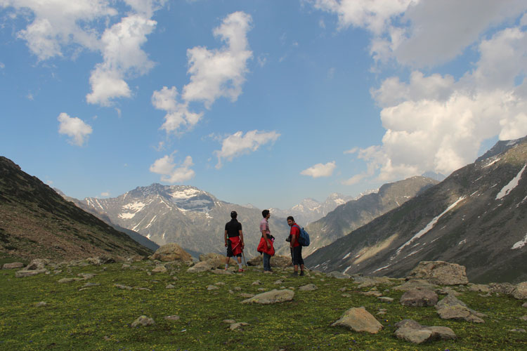 Hikers take a brief pause while returning from Tarsar lake in Himalayan valleys of Kashmir. Photo by Shafat Mir