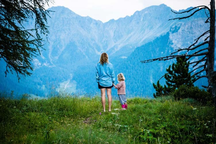 Mother and daughter travel to see different mountains.
