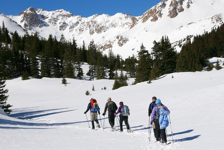 Snow shoeing to the mountains in Vail, CO.