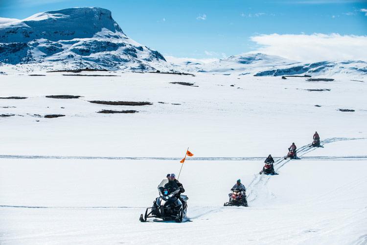 Virtual travelers tour the frozen landscape riding on snowmobiles.