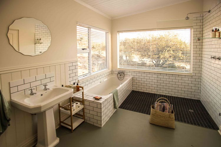 Scrub up after a day of outdoor activities in the Burchells master bathroom.