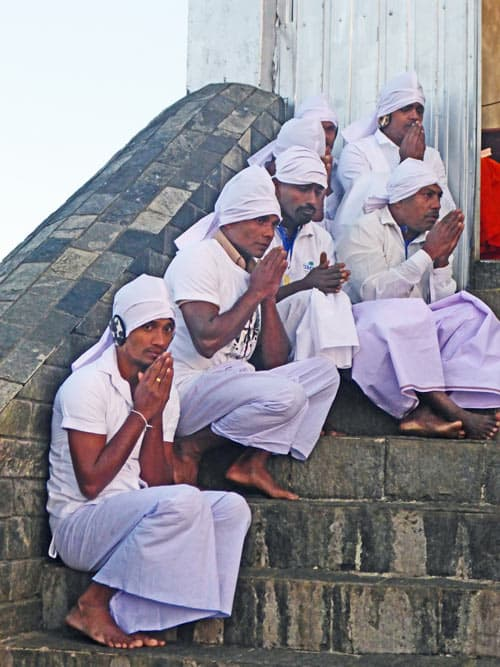 Buddhist monks praying on the summit of Adam's Peak.