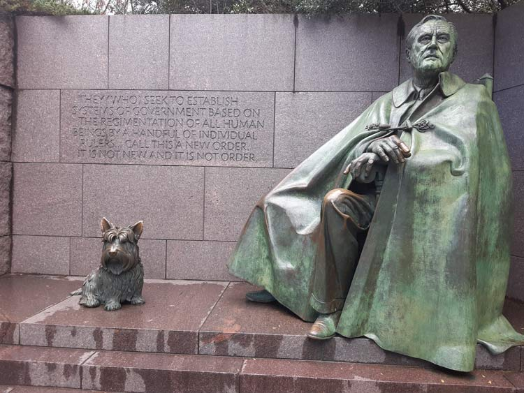 The FDR monument which includes a moving quote and his canine companion.