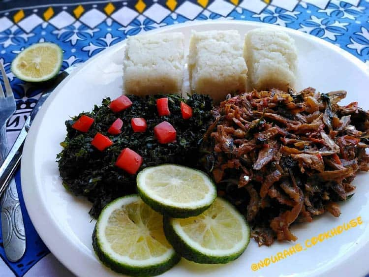 Another plate found in Kenya full of Ugali, Omena and vegetables.