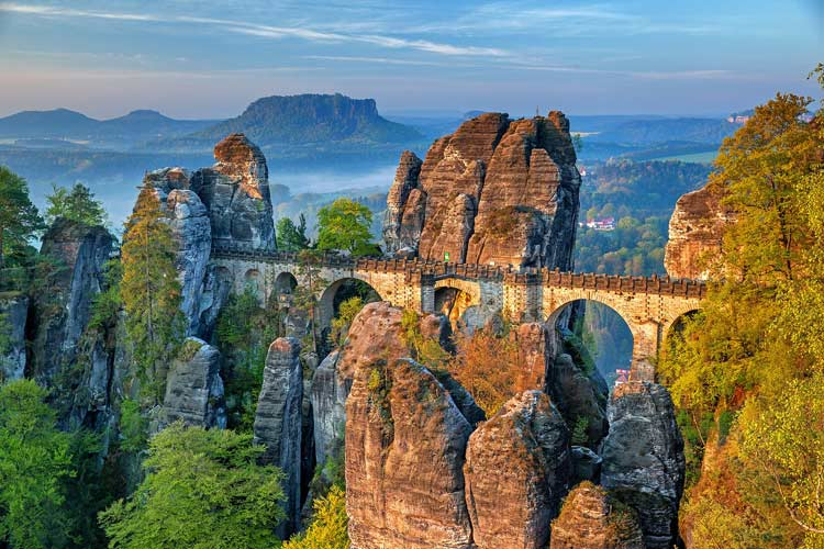 The Bastei bridge blends in well with the towering, jagged cliffs it was built into.
