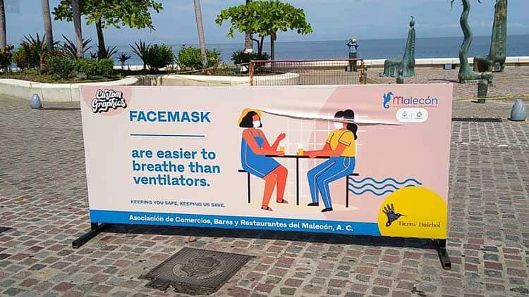 Reminders to wear face masks around the popular beach area.