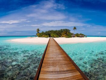 Walk over ocean to a beach in Maldives.