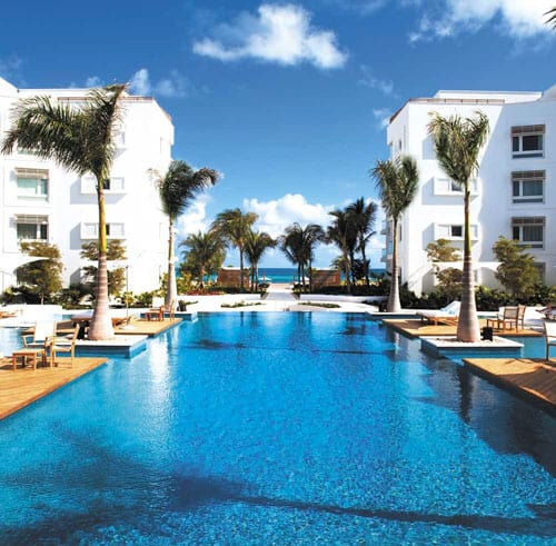 Sunny oceanfront pool at The Palms Turks and Caicos