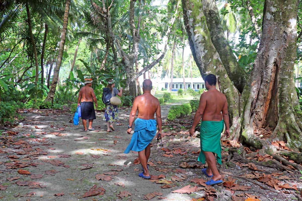 Men wearing traditional attire on on the outer island of Woleai in Yap