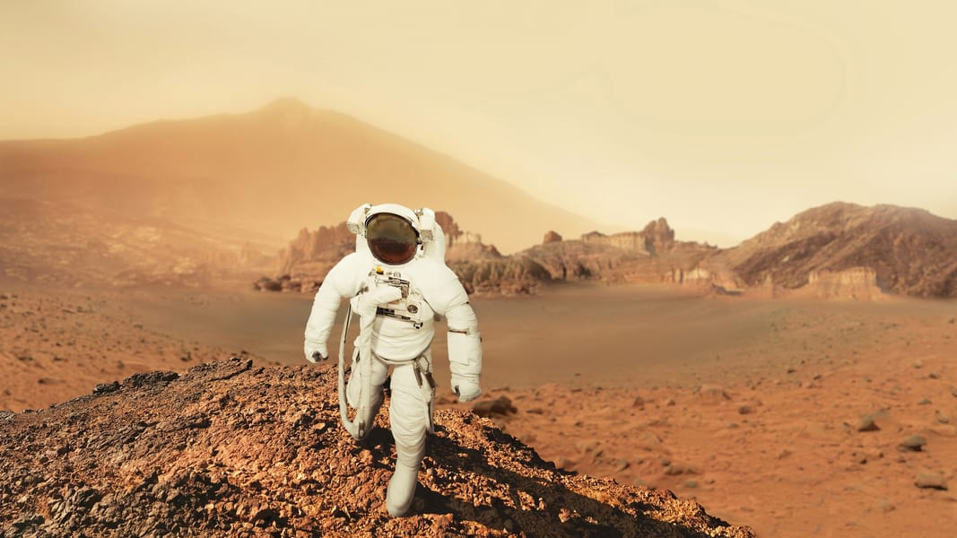 An Astronaut training in Mars-like landscape. Photo by Ales Utouka/Dreamstime.com