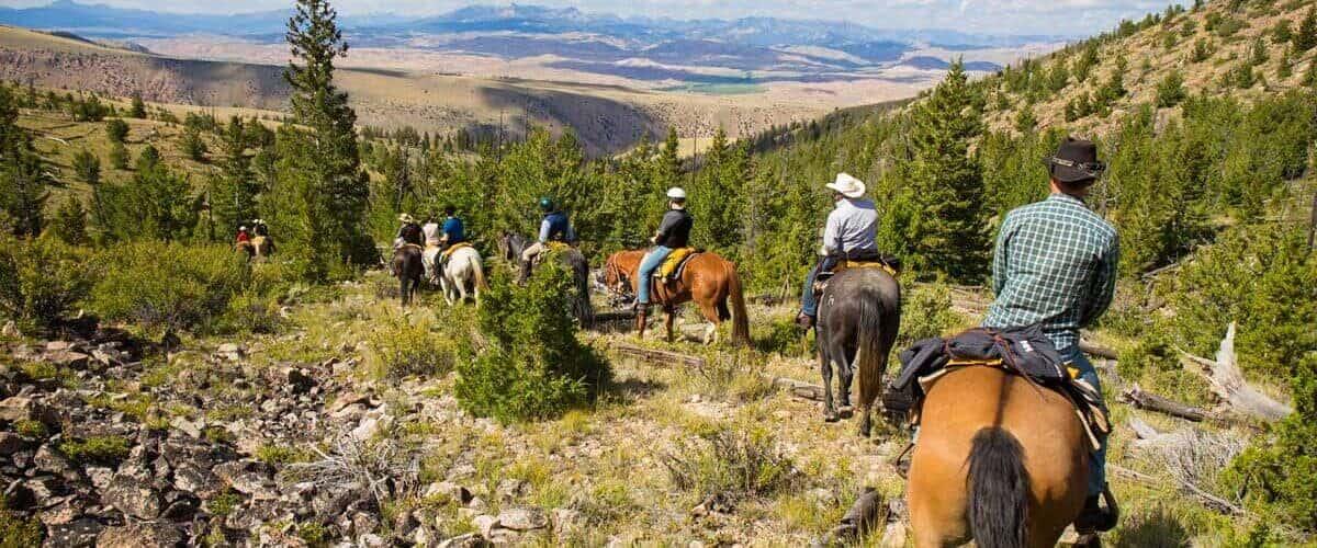 Horseback riding during a family dude ranch vacation.