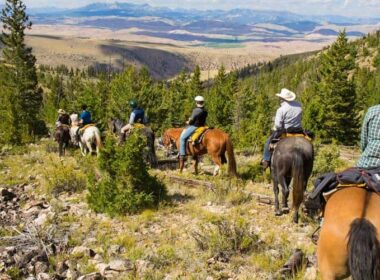 Horseback riding during a family dude ranch vacation.
