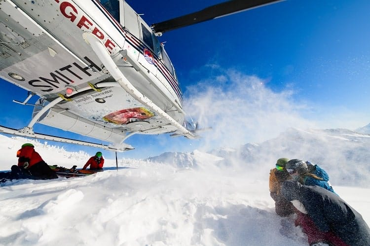 Heli-skiing arrival at top of the mountain