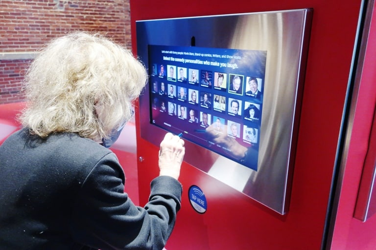 The author selecting her humor profile at the National Comedy Center in Chautauqua, New York. Photo by Victor Block