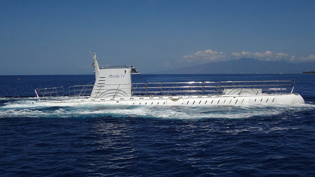 The Atlantis Submarine in Maui surfacing after an underwater trip.