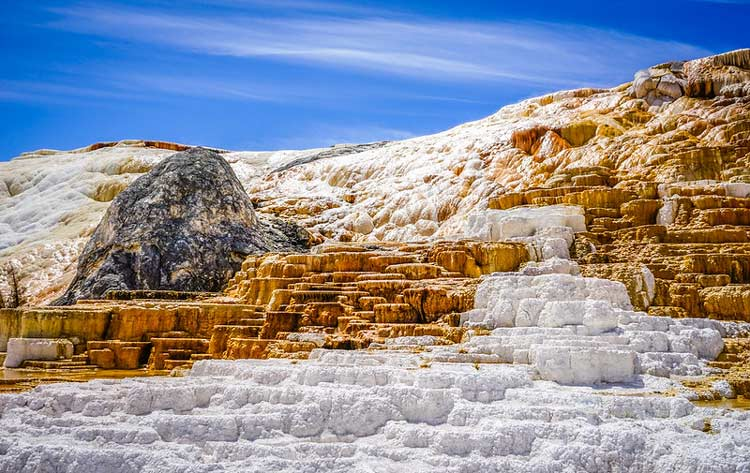 Mammoth Hot Springs lightly covered in snow over some rocks