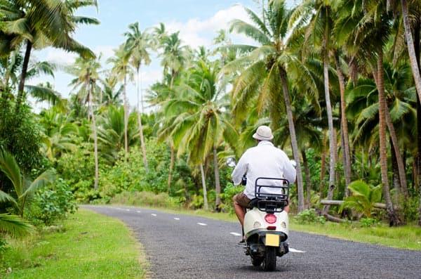 Scooter transportation around the lush Aitutaki Island