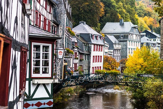 Bridge decorated over river through town of Monschau