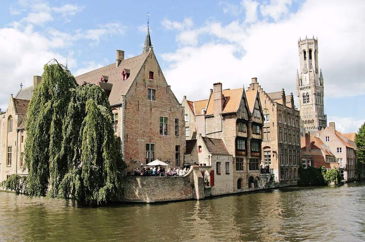 Couples can delight visiting the Belfry Tower in Bruges, Belgium during their romantic getaway