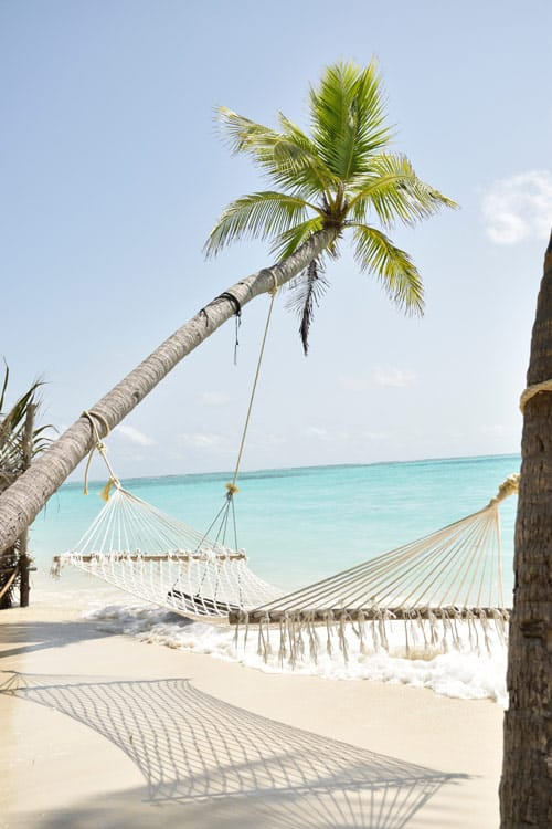 A hammock on a beach in the Maldives travel during COVID-19