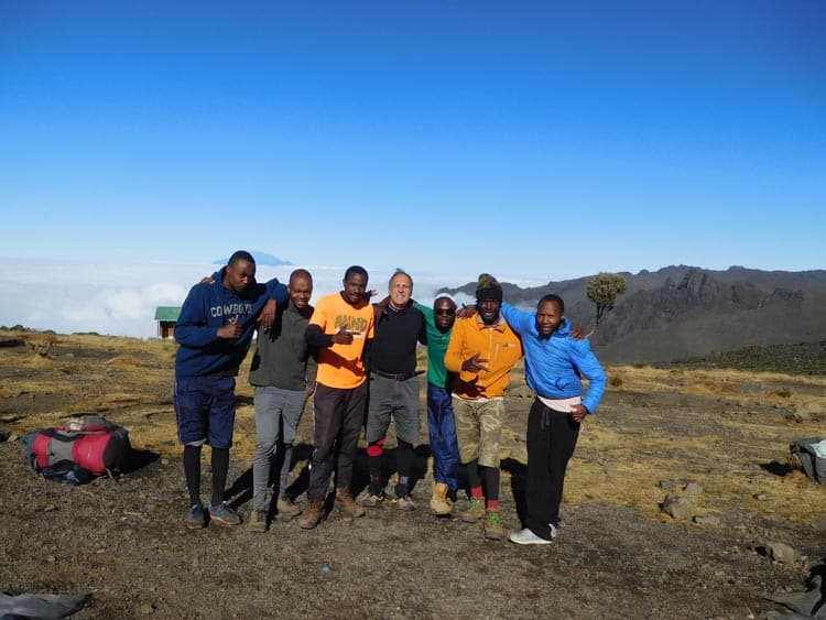 Social distancing on the mountain, my climbing experts on Mt. Kilimanjaro in Tanzania. Photo by Tony Mangia