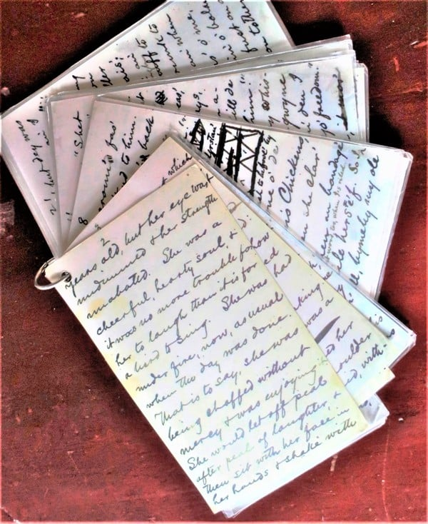 Copies of Mark Twain's own handwritten story notes are on the desk in his study on the Elmira College campus in upstate New York. Photo by Victor Block