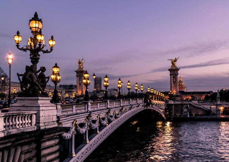 Wander above the Seine at dusk in Paris