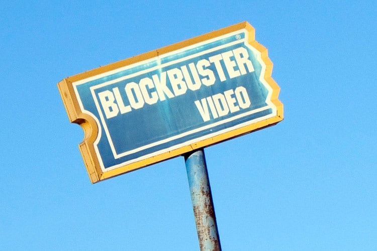 """""""Be Kind. Rewind!"""" The final Blockbuster Video lives in Bend, Oregon, waiting to escort you to a time before video streaming services took over. flickr CC Image by Trebomb"""