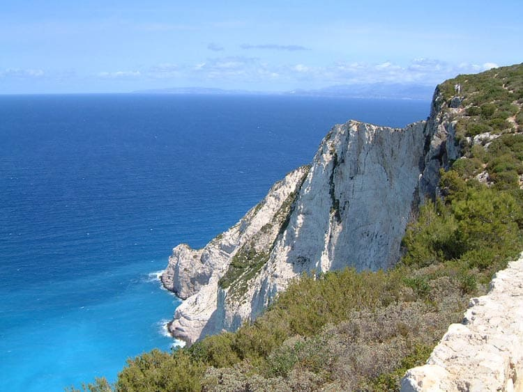 Zakynthos provides a picturesque view of crystal blue water of Greece. CC Image by Chris Hills