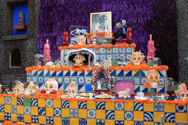 The public altars at Day of the Dead are dedicated to deceased dignitaries, and create an explosion of color