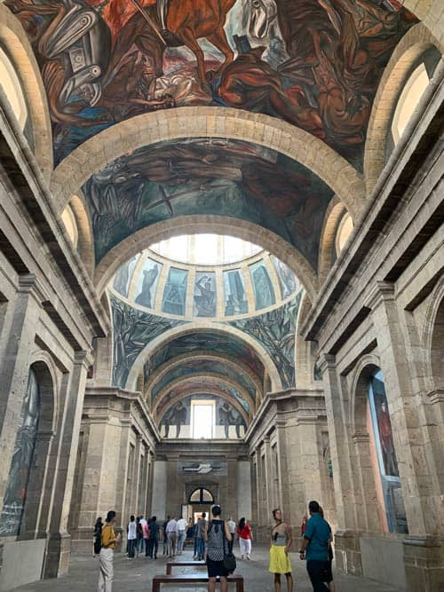 The Instituto Cultural Cabañas tells a story through murals on the walls, ceiling and domes by José Clemente Orozco. Photo by Maribeth Mellin
