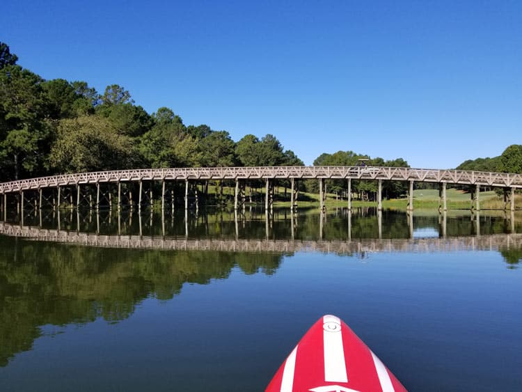 Paddleboarding around the Ritz Carlton will take you near the Lake Oconee Golf Course. Photo by Carrie Dow