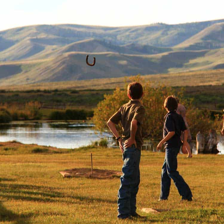 Playing horseshoes on a dude ranch vacation