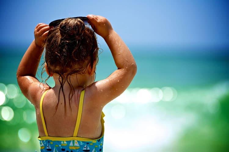 Kids enjoy the fun in the sun and ocean at the beaches of Destin, Florida