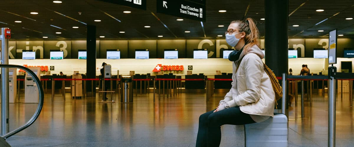 Travel in airport with masks during pandemic.