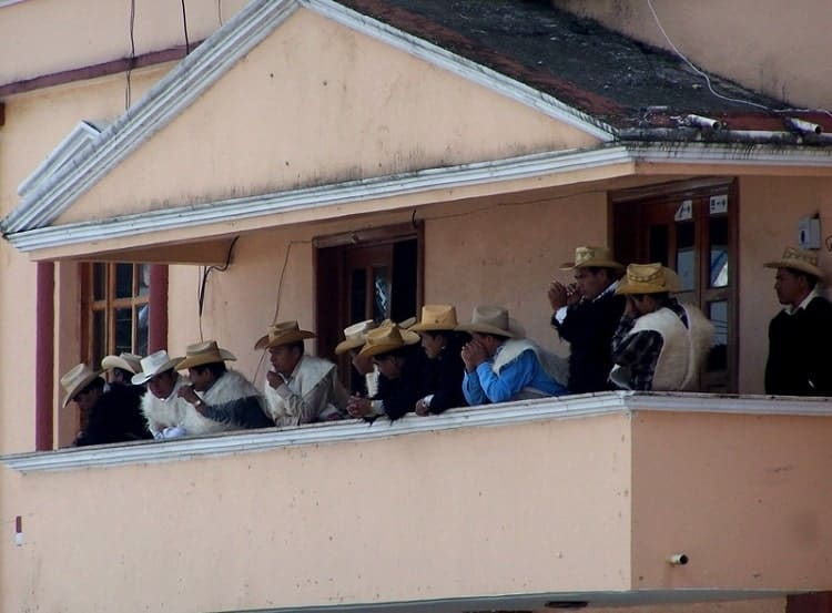 Village elders lined on a balcony in Chiapas