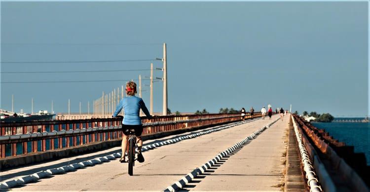 A biker on Seven Mile Bridge in the Florida Keys. Photo by Arinakabich08/Dreamstime.com