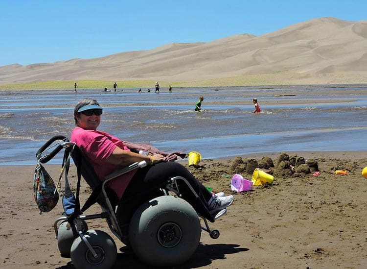 Great Sand Dunes has a limited number of special wheelchairs available for loan that can make it through the sand. CC Image by Great Sand Dunes National Park & Preserve/Patrick Myers