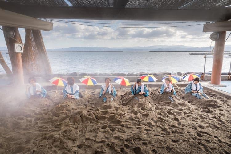 Try a sand bath in Ibusuki, Kagoshima. Photo by KPVB
