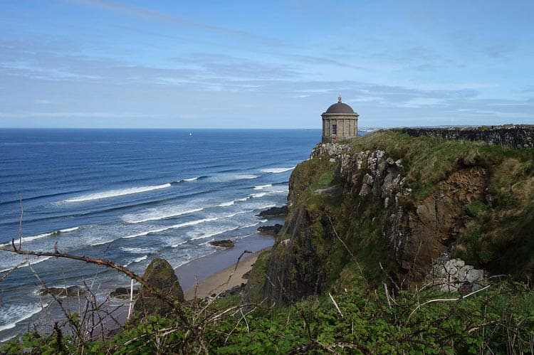 The Mussenden Temple sits atop a cliff above the Downhill Demesne. CC Image by Philip McErlean