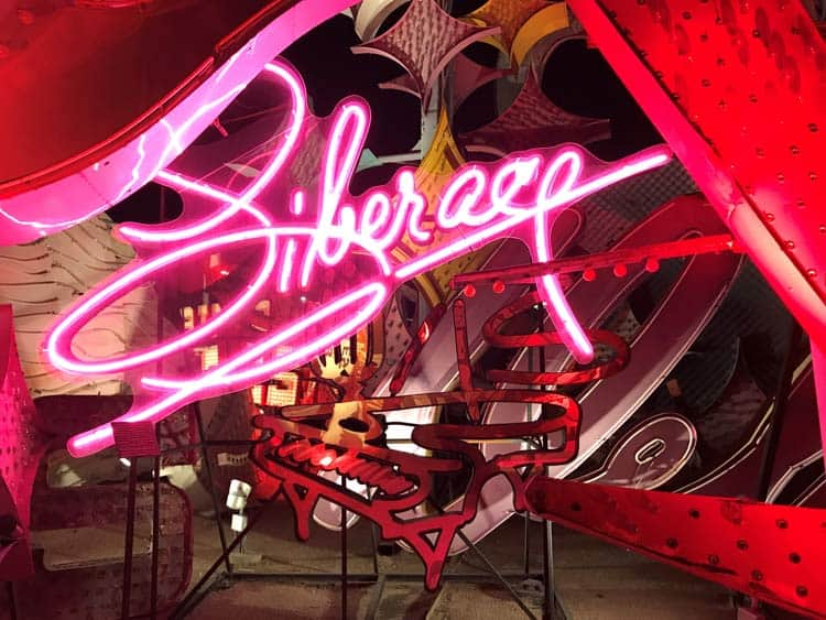 Signs at the Neon Museum at night in Las Vegas