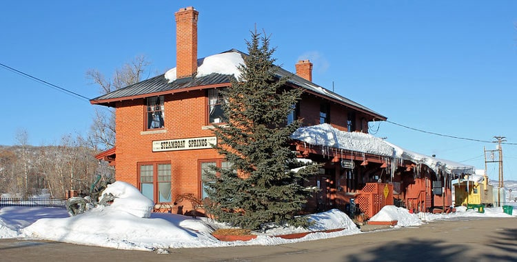 The railroad was constructed in 1903, the historic Steamboat Springs Depot was open to passengers in 1909 but closed in 1968, now the beautiful building remains a reminder of the past and history of Steamboat. CC Image by Jeffery Beall