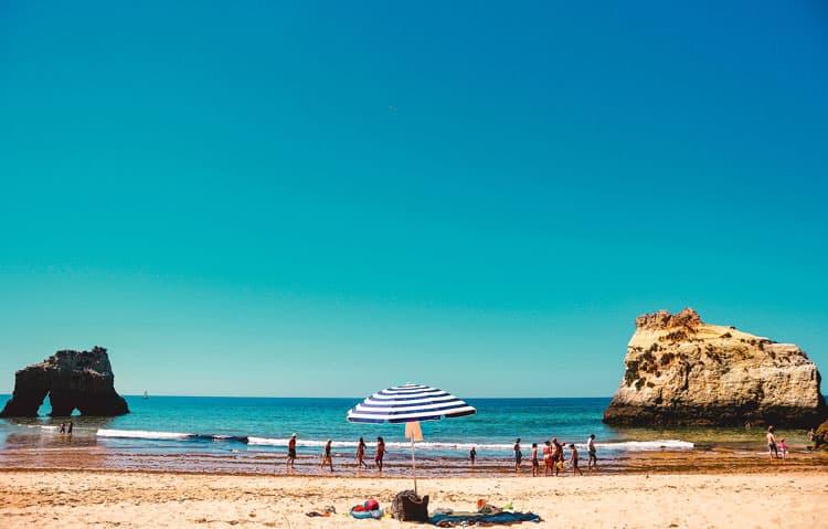 Sunny Praia Do Camilo beach in Portugal