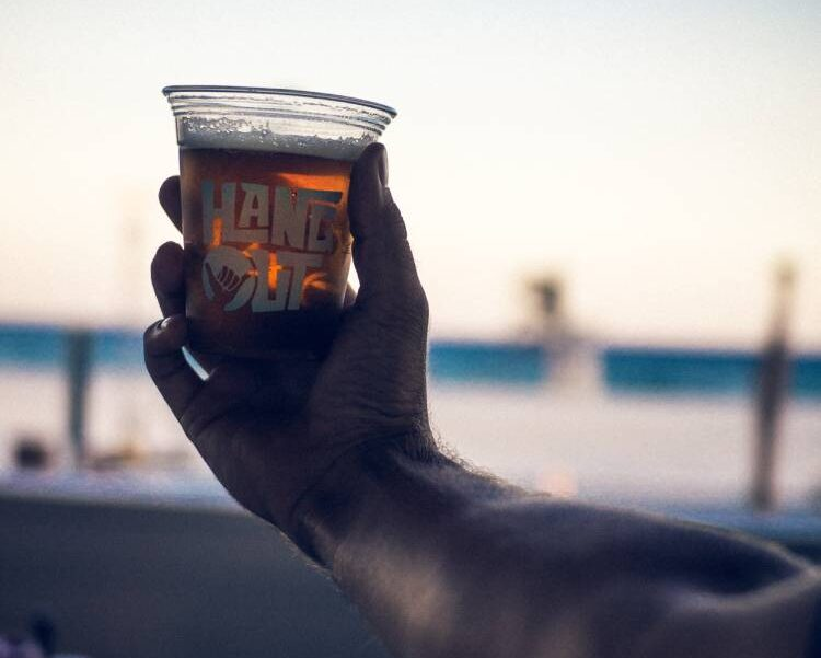 Enjoying a beverage on the beach