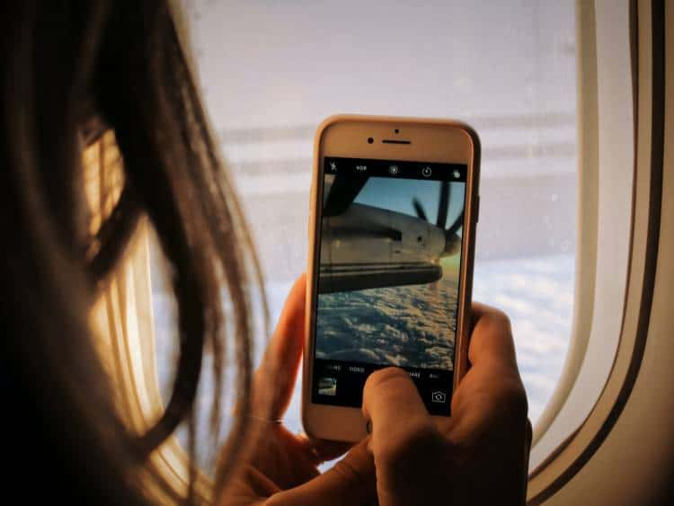 Living in a digital world. Traveling again by airplane. Photo by Patrick Tomasso